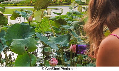 Closeup Backside Blond Girl Photos Lotus Flower in Park -...