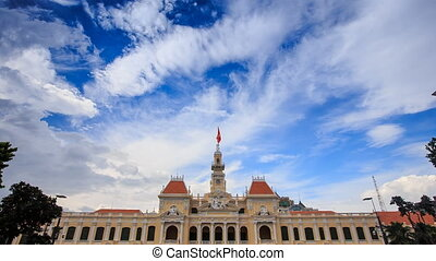 Wind Shakes Flag on Government Building in Vietnam - wind...