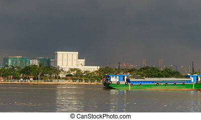 Large Vietnamese Tourist Boat Drifts by City Coast - view of...