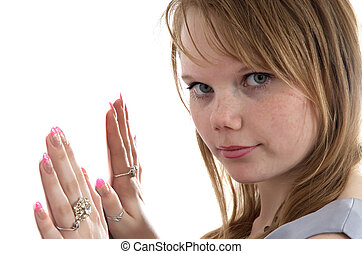 making look younger girl keeps hands on white background