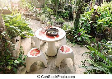 home garden - round table in home garden, garden decoration