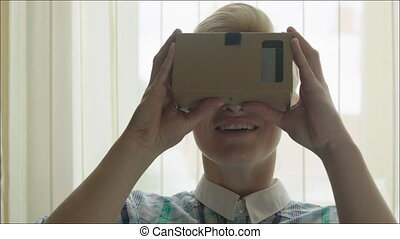 Smiling Woman Exploring Virtual Reality - Young smiling...