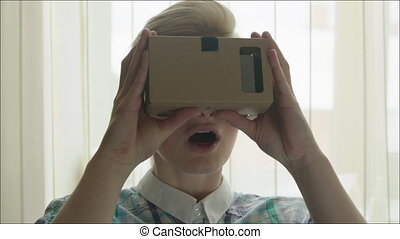Young Woman in Virtual Reality Glasses - Young woman is...