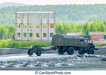army truck transports gun after water ford - Nizhniy Tagil,...