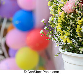 Chrysanthemum ornamental in white flowerpot with balloon...