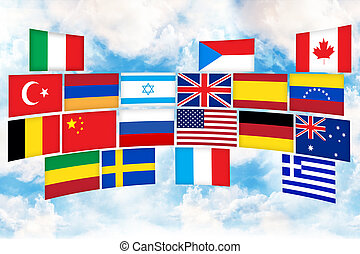 Many flags of different countries on the sky background