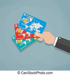 Hands holding bank cards