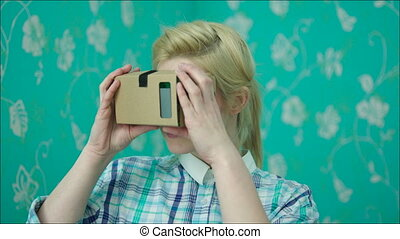 Young Woman Surprised with Virtual Reality - Young woman is...