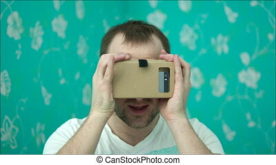 Surprised Man in Virtual Reality Glasses - Young man is...