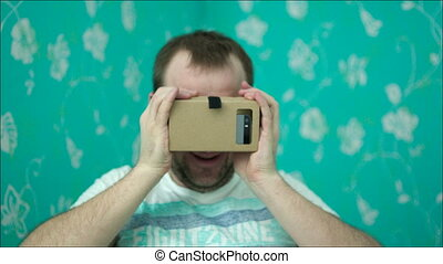 Man in Virtual Reality Glasses Giving Thumbs-Up - Young man...