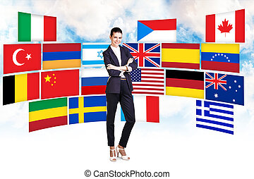 Woman and different countries flags - Business woman stands...