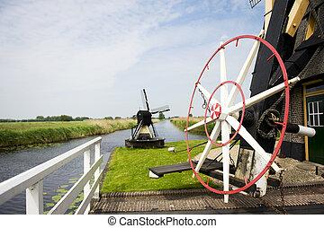 Alblasserwaard Goudriaan - Dutch windmill near the river in...