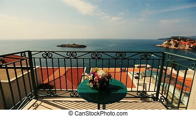 Wedding bouquet with spring flowers on table on the terrace with sea view of Montenegro, Budva