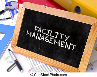 Facility Management - Chalkboard with Hand Drawn Text.