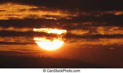 Sundown 2 - The Sundown sun on river.