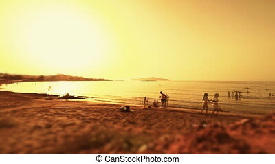 Sunny beach panorama - Sunny beach panorama with people at...
