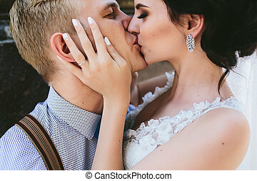 Wedding couple kiss each other