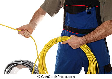 installing a data cable - a worker is installing a yellow...