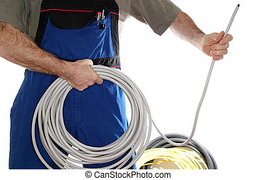 electrician is holding a wire - electrician is installing a...