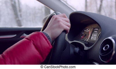 Woman Hands on Steering Wheel of a Car - Closeup shot of a...