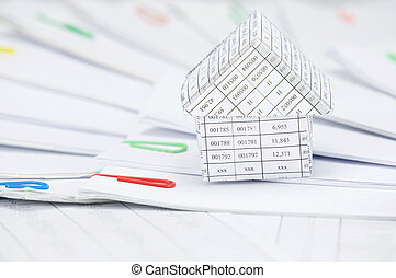 Close up house with step of paperwork with colorful paperclip