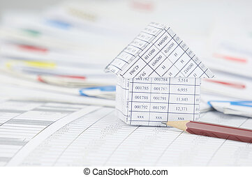 Close up house with pencil have step paperwork as background