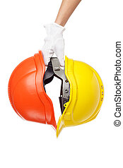 Construction helmets in the hand, isolated