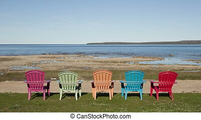 4K Time lapse shadow over colored chairs at lake - Time...