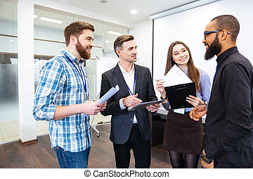 Group of confident business people on meeting with team...