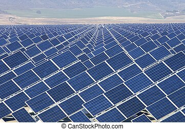 solar energy - huge solar field with the background fields