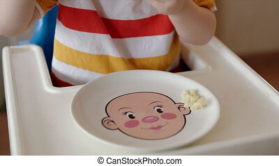 Child Eating Pasta from Funny Plate - Closeup shot of a...