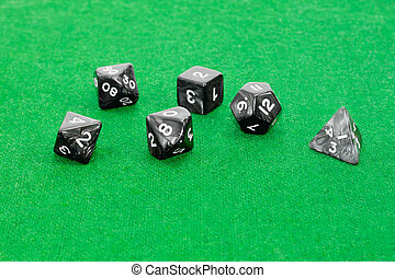 Specialized polyhedral dice for role-playing games on green...