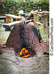 Old slavic furnace made of clay and stones