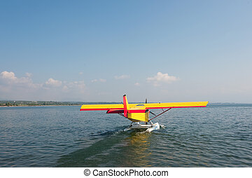 Water air plane - Air plane over the water in red and yellow