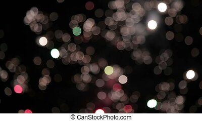 Bokeh and blur of fireworks exploding at night in the sky....