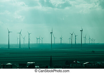 windmills -  windmills over green field image