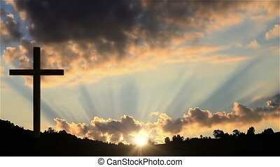 Big Cross at sunset - One Christian cross on a hill at...