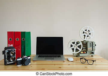 Business workplace with laptop and retro objects on wooden table