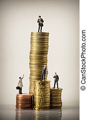 Business people and euro coin piles