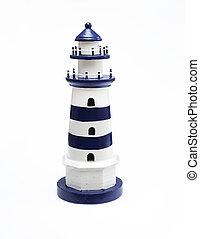 Decorative dark blue lighthouse isolated on white background