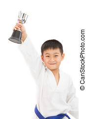 Asian Little Karate Boy Holding Cup in White Kimono on White...