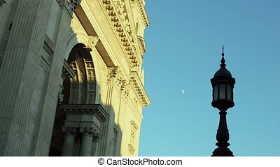 Street Lamp Against the Sky with the Moon in the Day.