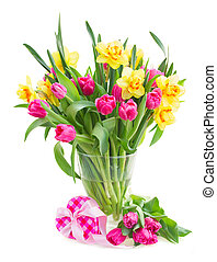 bouquet of yellow daffodils and pink tulips isolated on...