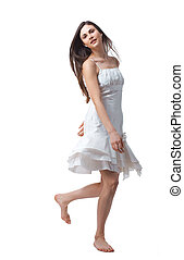 Free time - Young beautiful woman jumping on white...