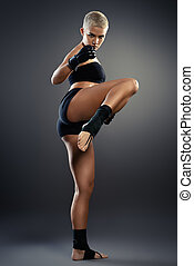 kickboxer - Professional athlete woman fighter with a...