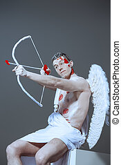 loving sacrifice - Male angel Cupid with a bow and arrows of...