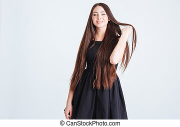 Attractive woman with beautiful long dark hair in black dress