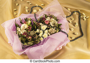 beautiful bouquet of flowers, black pearls on Golden organza