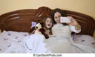 with a child doing selfie mom