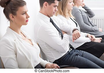 Tired people in queue - Image of tired people in queue to...